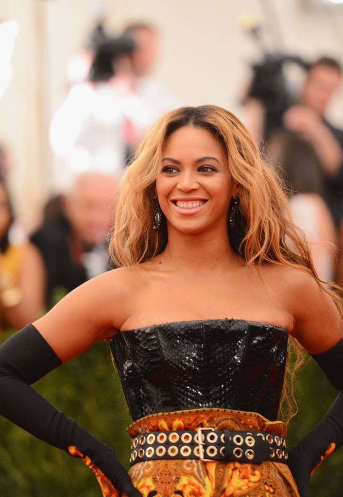 Beyoncé accessorized her custom Givenchy look with a tough-girl belt, dramatic elbow-length gloves, and Lorraine Schwartz jewels.