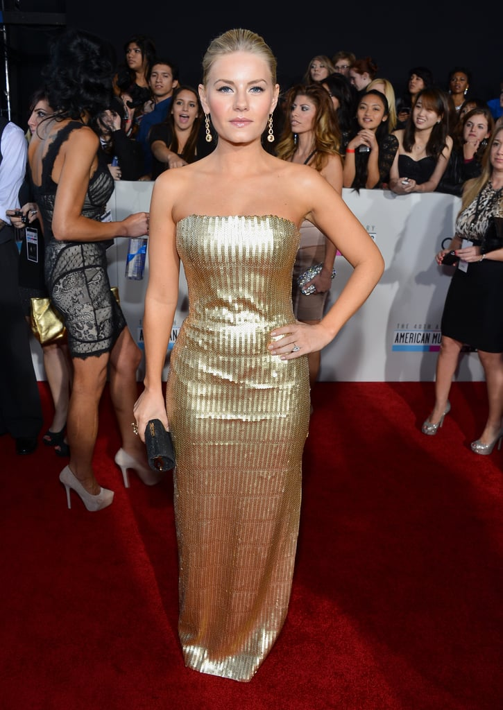 For a major event, look to Elisha Cuthbert to garner some styling fodder. Opt for a streamlined strapless in an attention-getting metallic — and take note: just like Elisha, you need only a touch of accessories to finish it off.