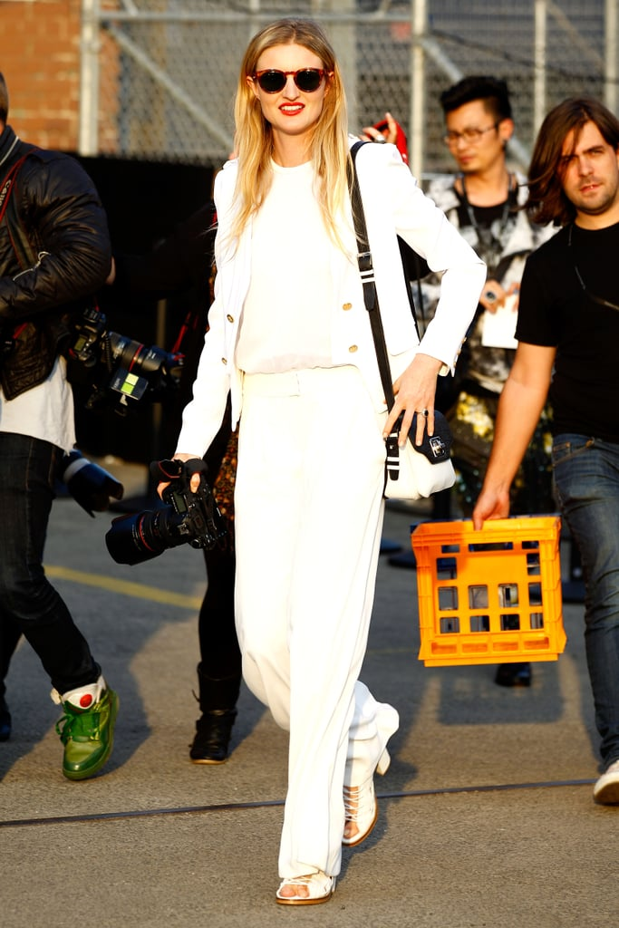 All white feels definitively like Spring, but this showgoer layered it up to safeguard against breezier days.