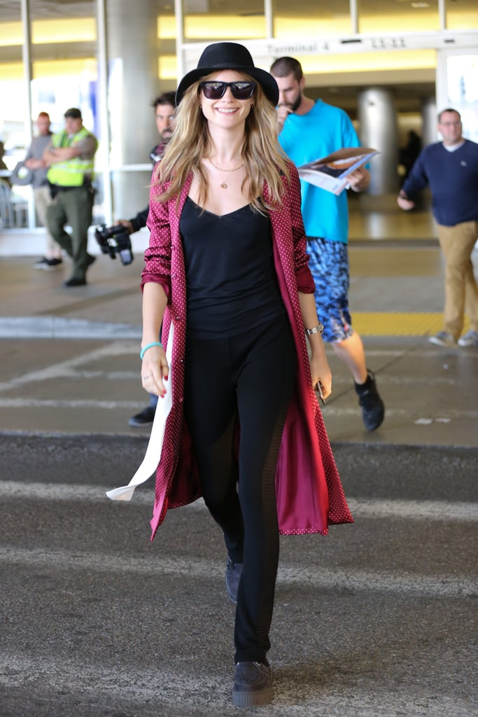 Behati Prinsloo proved a pop of red never hurts (and neither does a hat).