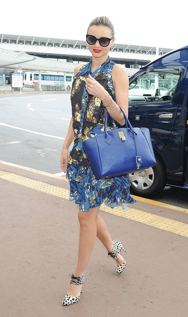 Miranda Kerr greeted waiting fans as she headed into Tokyo airport on July 24.