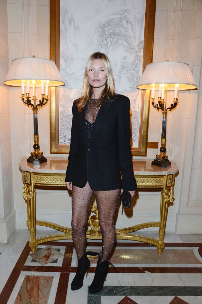 Kate Moss rocked a risque, studded bodysuit on Tuesday night in Paris during Fashion Week.