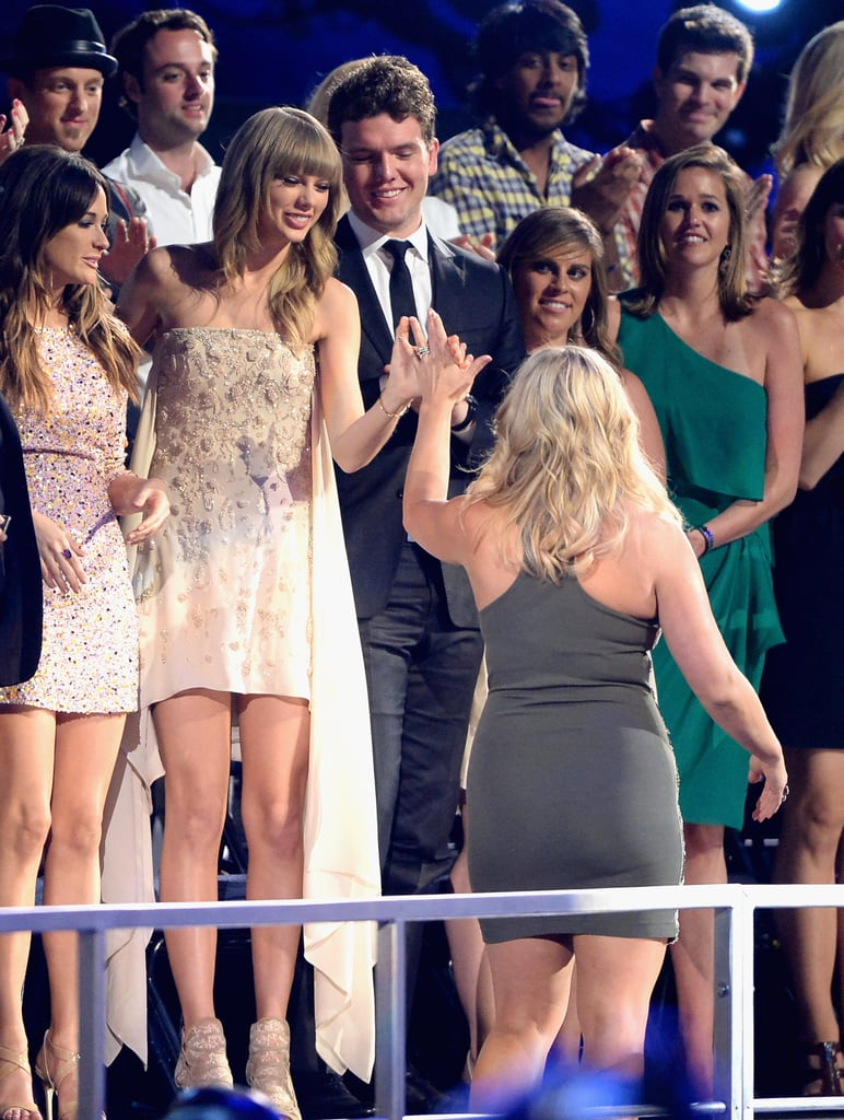 Taylor Swift high-fived Miranda Lambert as she made her way to the stage to accept an award.