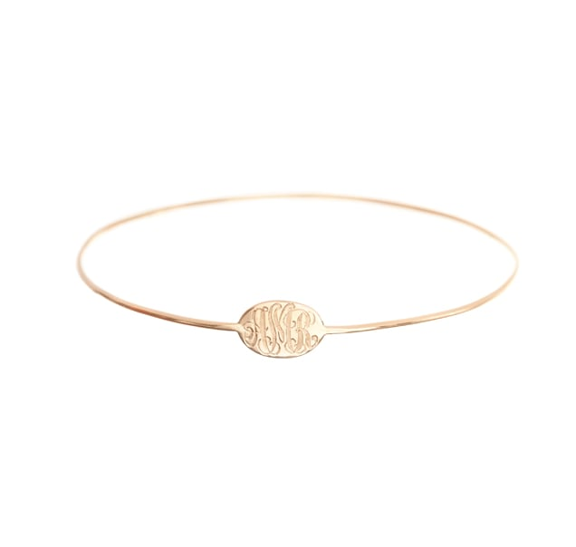 Use Ariel Gordon's slim signet bangle ($360-$875) to remind a grad that no matter where the future might lead, she's always herself.