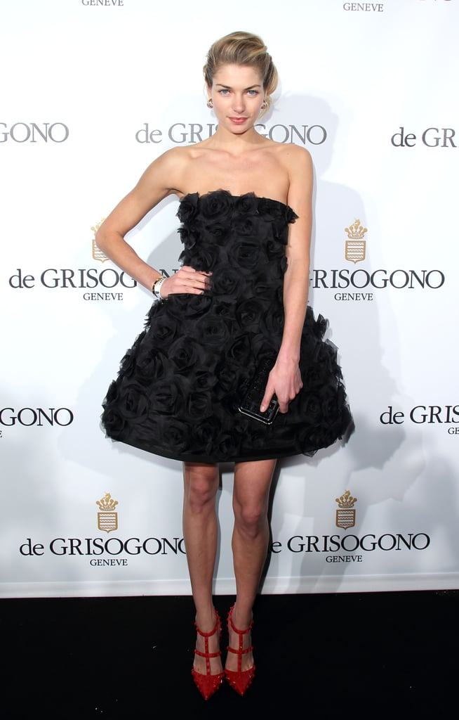 Jessica Hart took the flirty route in a little black strapless and textured dress and red studded pumps at the de Grisogono party.