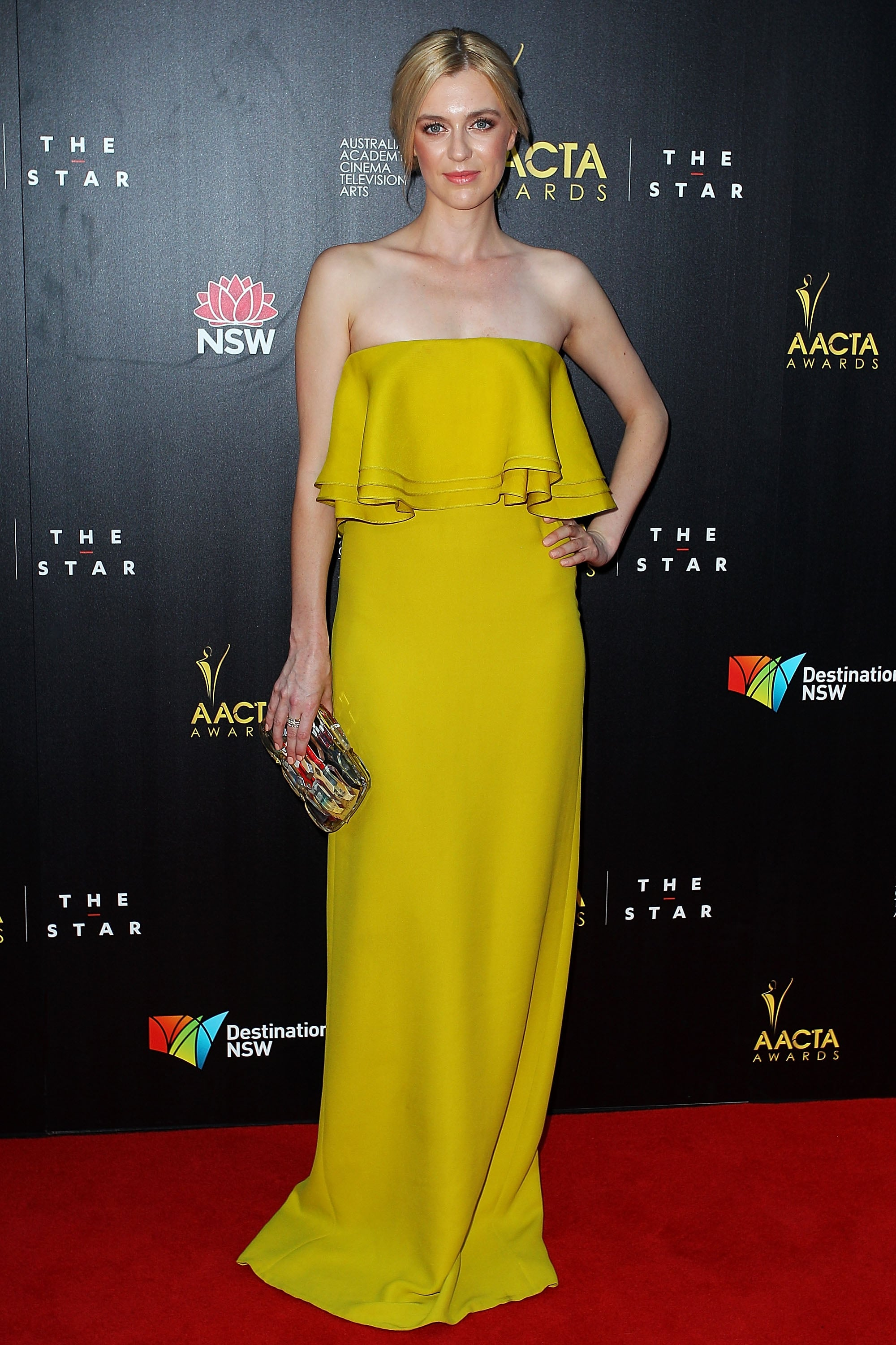 Gracie Otto wore a yellow strapless gown.