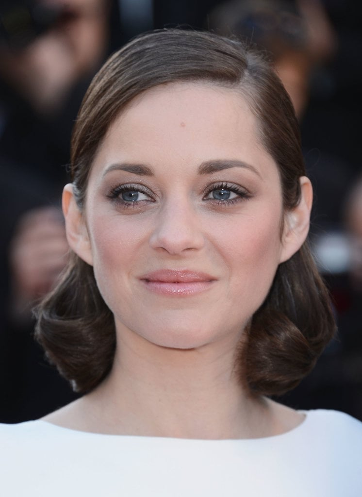 Marion Cotillard looked as cute as pie with tight curls and rosy cheeks.