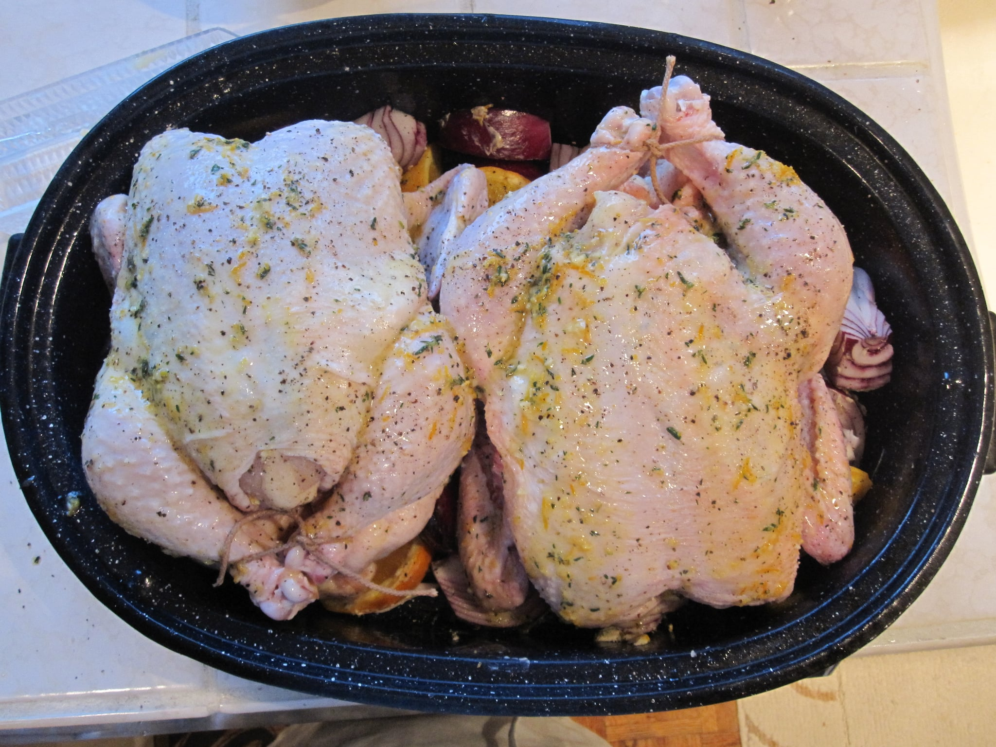 Garlic-Butter Rubbed Chicken With Roasted Oranges and Red Onions