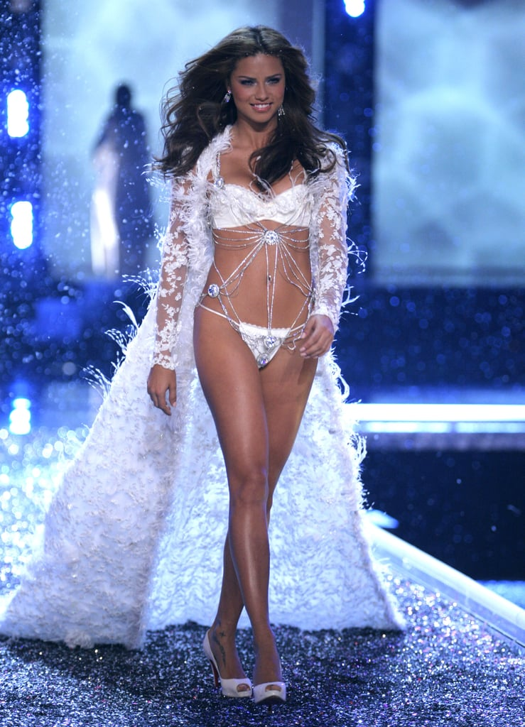 Adriana Lima strutted her stuff in a white two-piece for the Victoria's Secret Fashion Show in LA in November 2006.