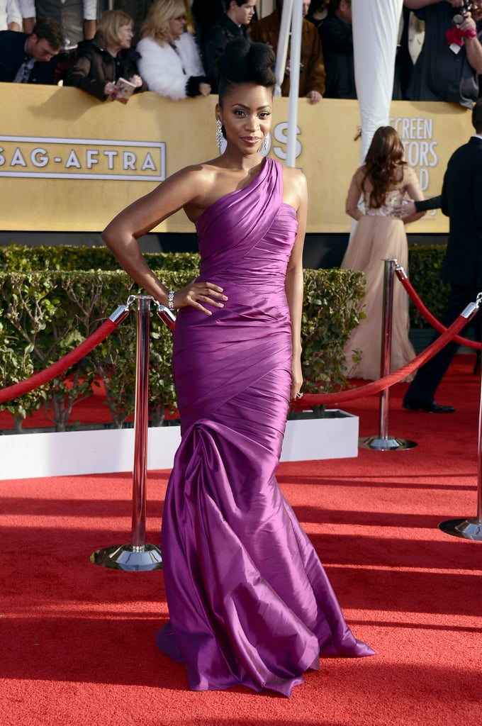 Teyonah Parris worked the red carpet in a violet satin one-shoulder confection with diamond chandelier earrings and a matching bracelet.