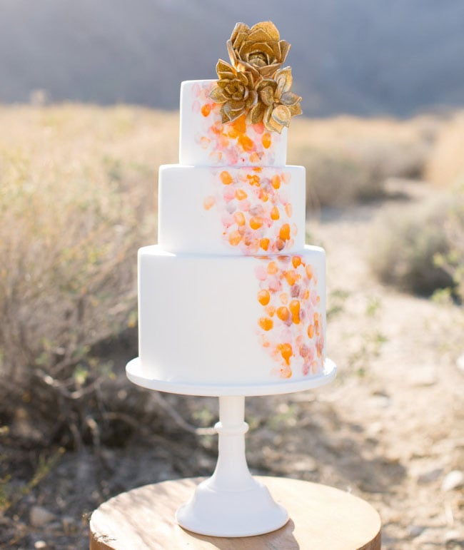 Gold succulents (yes, you read that right) top off this amazing and unique wedding cake.  Photo by Birds of a Feather via Green Wedding Shoes