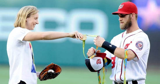 Katie Ledecky Makes Man Hold Her Medals While She Throws Out First Pitch