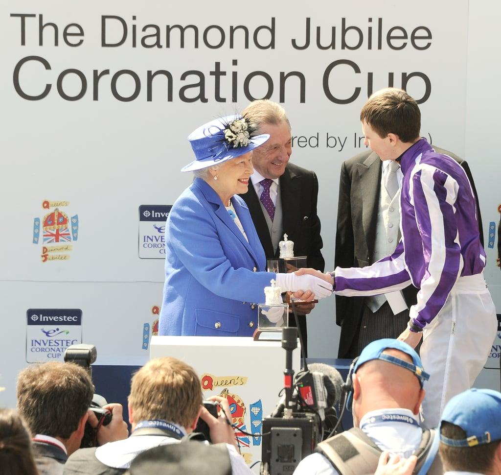 Queen Elizabeth II presented the Diamond Jubilee Coronation Cup to jockey Joseph O'Brien, trainer Aidan O'Brien, and owners Derrick Smith, John Magnier, and Michael Tabor.