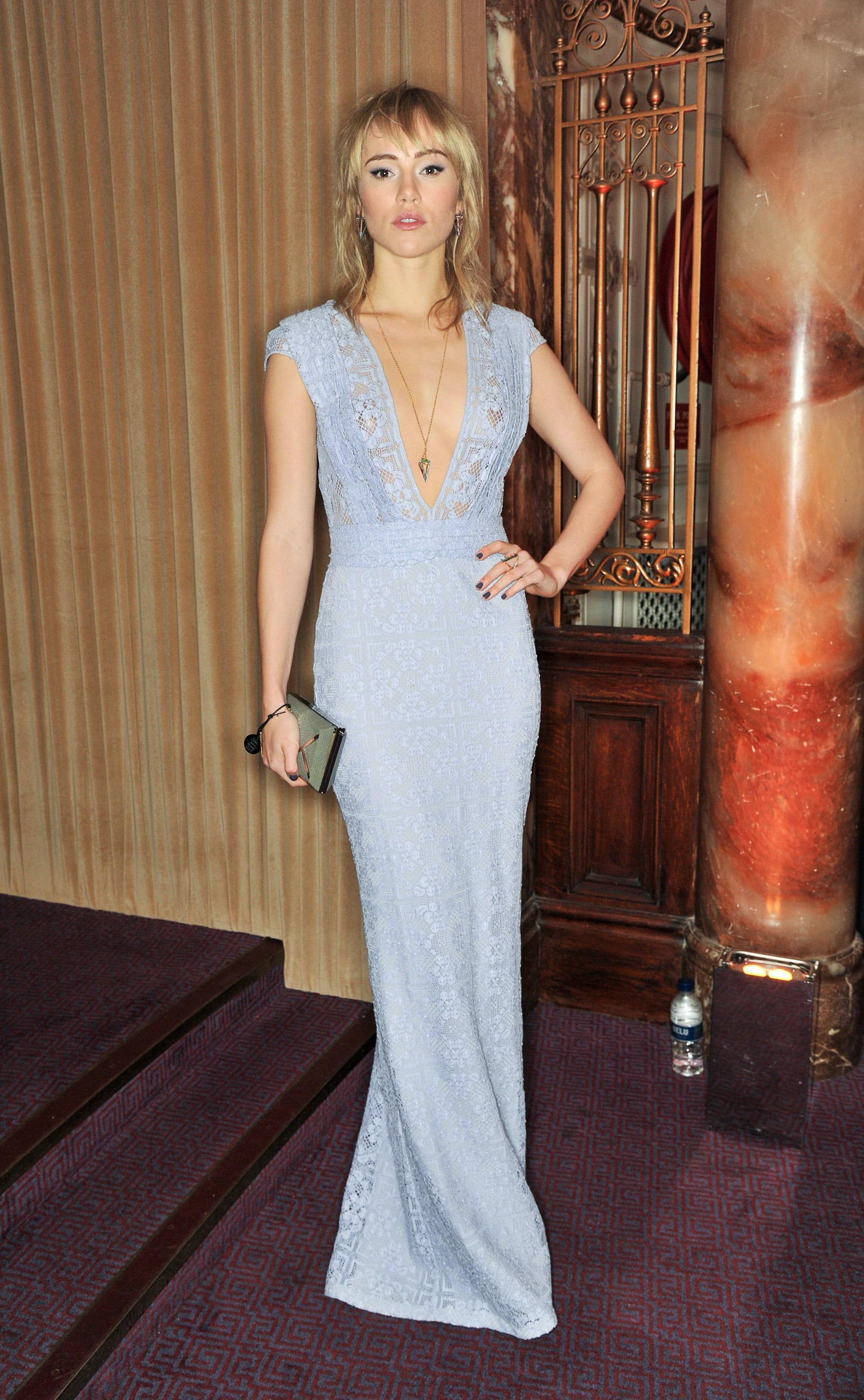Suki Waterhouse rocked a floor-length dress with a plunging neckline.