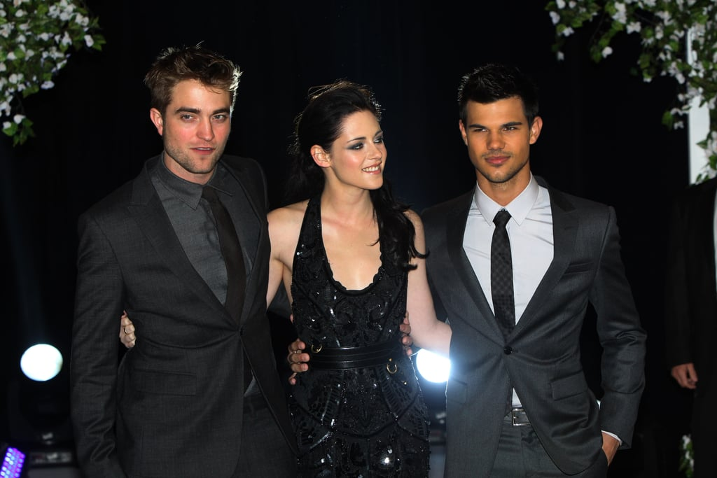 Robert Pattinson and Kristen Stewart with Taylor Lautner at the premiere of Breaking Dawn Part 1 in London.