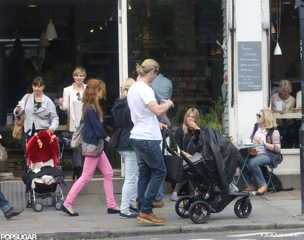 Chris Hemsworth chatted with Sienna Miller outside of a restaurant in London.