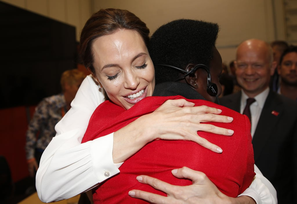 On the first day of the summit, Angelina embraced Esther Ruth Atim of Uganda.