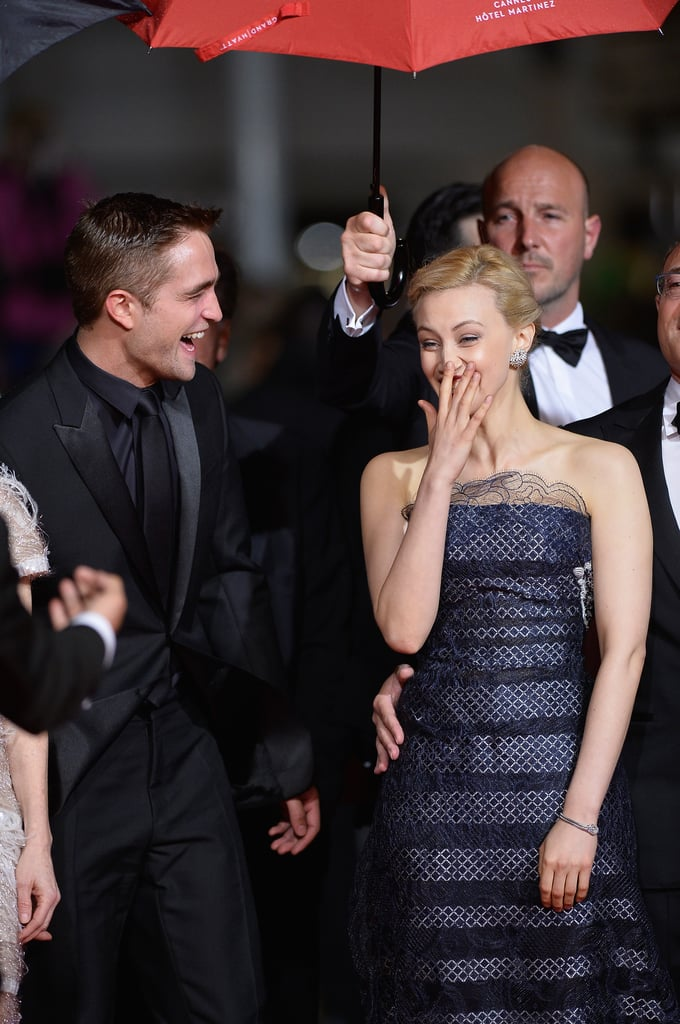 Sarah Gadon made Robert Pattinson laugh at the premiere of Map to the Stars at Cannes Film Festival on Monday.