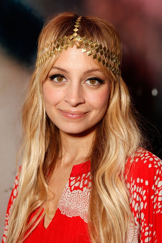 Nicole loves a good headband, and she coupled this gold one with beachy waves and winged liner in 2009.