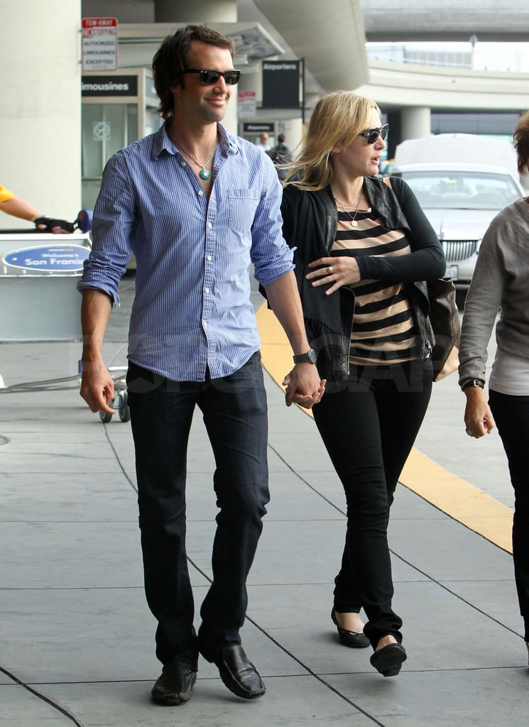 Kate and Ned made their way outside the airport.