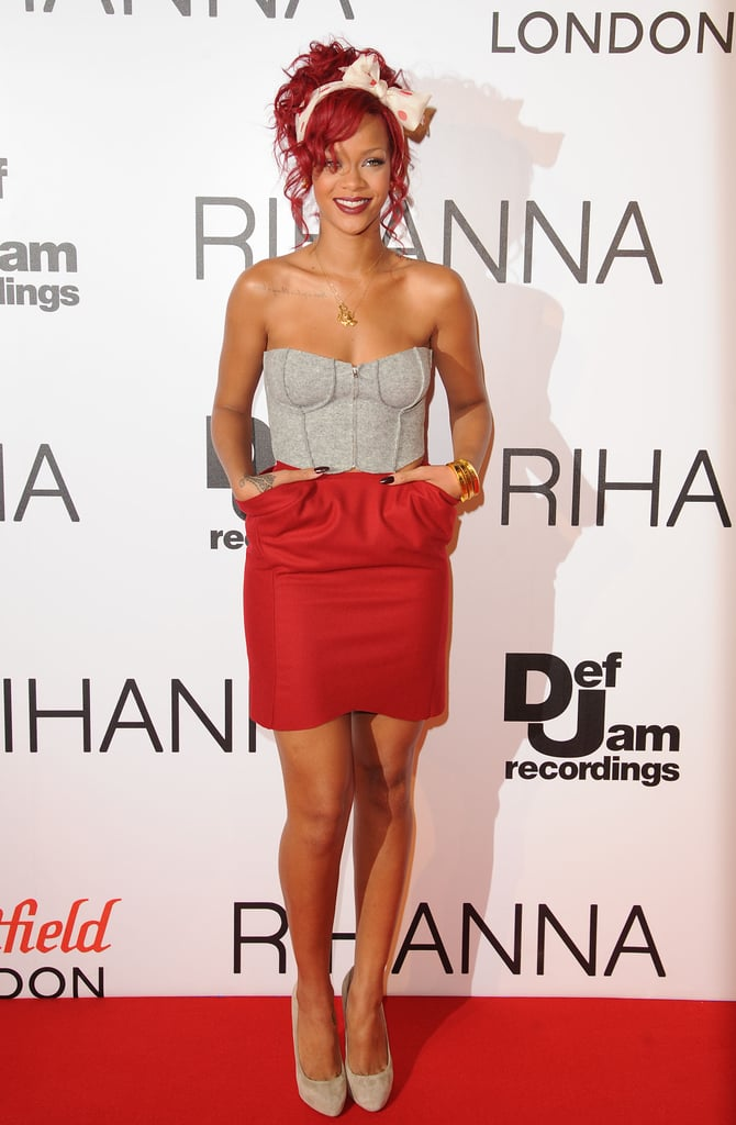 Rihanna looked radiant coordinating her fiery locks with a red pocketed miniskirt and gray bustier in London in 2011.