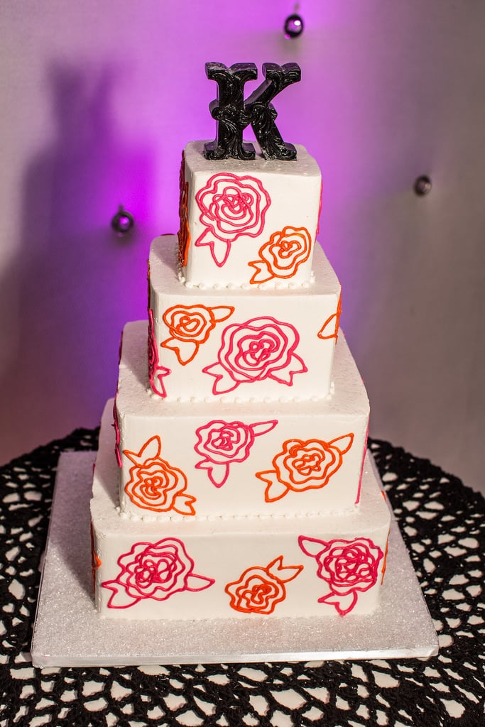 Don't the floral embellishments of this darling cake remind you of a textile? Not your grandma's curtains, though — with its vibrant colors, this is ultrachic.