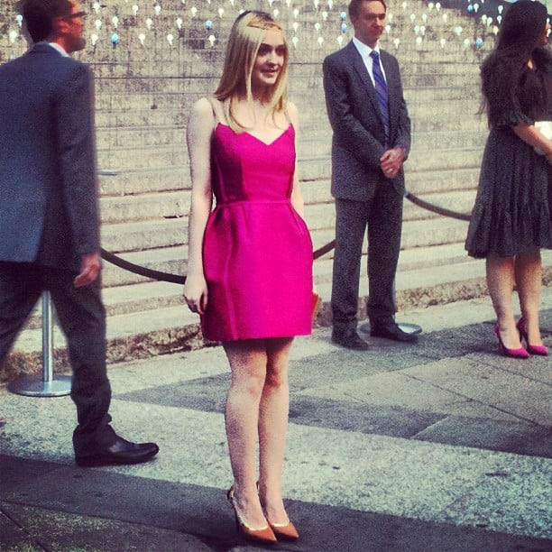 Ever the charming style setter, Dakota Fanning chose a hot pink Lanvin number to go with her nude pointy-toe pumps and gold halo.