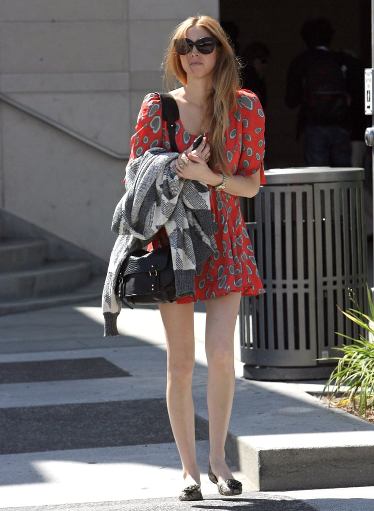 Whitney Port made a styled run in a sweet red sundress and flats.