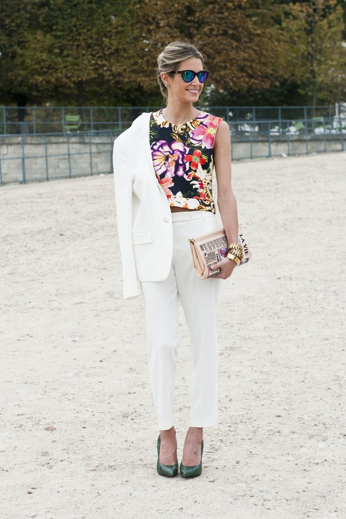 One way to break up an all-white suit? A flash of florals.
