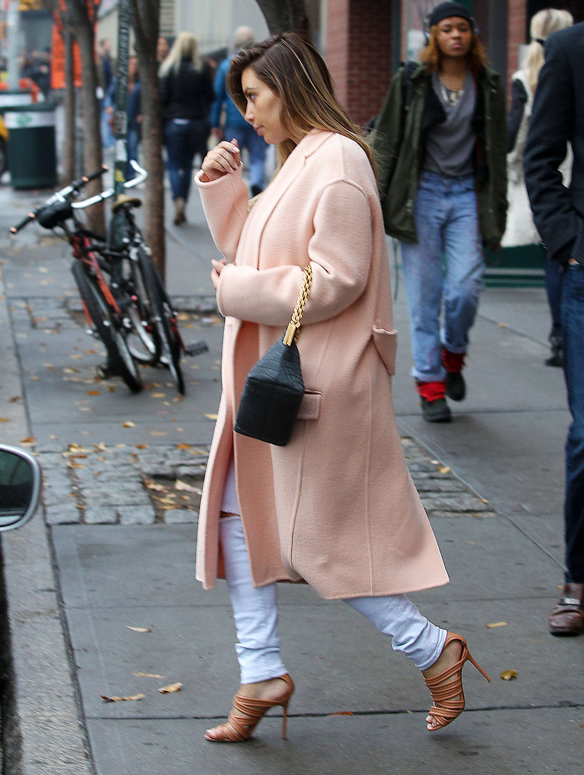 Kim Kardashian topped her monochrome ensemble with a plush pink Céline coat and strappy nude sandals in November 2013. Where to Wear: A drive-in movie.
