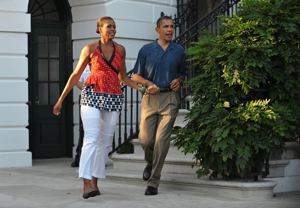 In 2010, Michelle and Barack hustled hand in hand to greet families at that year's barbecue.