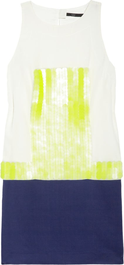 We love this cool spin on the classic shift dress — the colorblocking is sophisticated yet fresh, and the panel of paillettes gives a bit of fun flash.  Tibi Paillette-Embellished Silk Dress ($475)