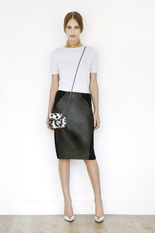Short Sleeved Cashmere Tee in Cream ($295), Leather Slim Skirt in Black ($1,195), Treasure Cross Body Pony Bag in Cream Leopard ($795), Addiction Pump in Specchio ($595) Photo courtesy of Tamara Mellon
