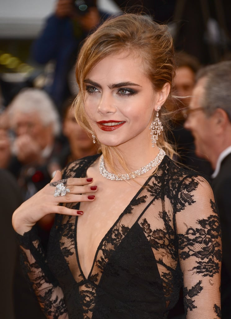 Cara Delevingne wore a Chopard diamond ring and necklace and Chopard earrings.