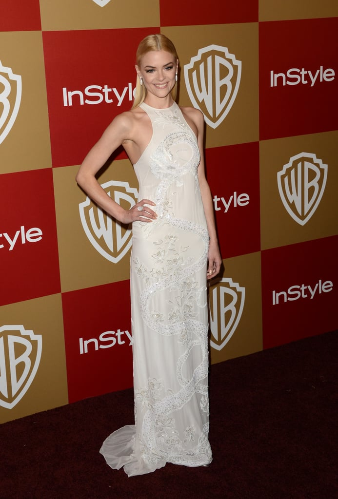 Jaime King stepped out at the InStyle party in a crisp white embroidered halter-style Emilio Pucci dress which only emphasized her svelte figure. She kept her hair sleek and pulled back into a half-ponytail, which totally worked here.