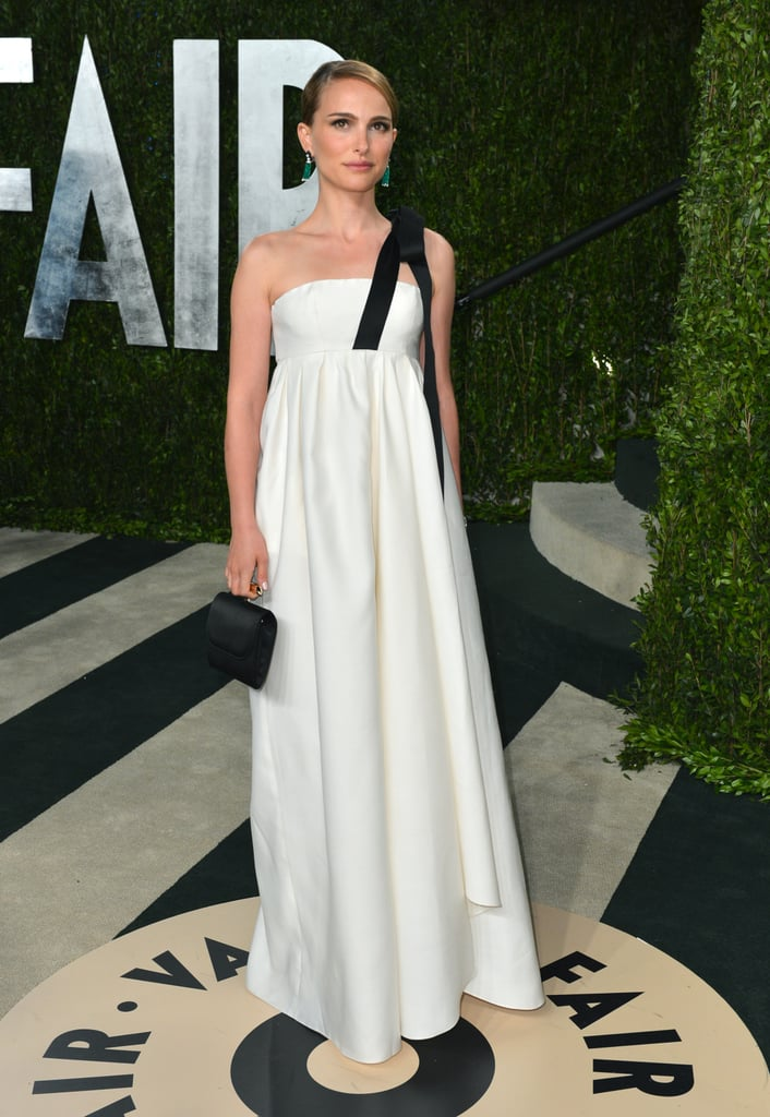Dior also made an appearance at the Vanity Fair Oscars afterparty. Natalie Portman donned a Dior white silk gown with black ribbon detail and a matching Dior clutch.