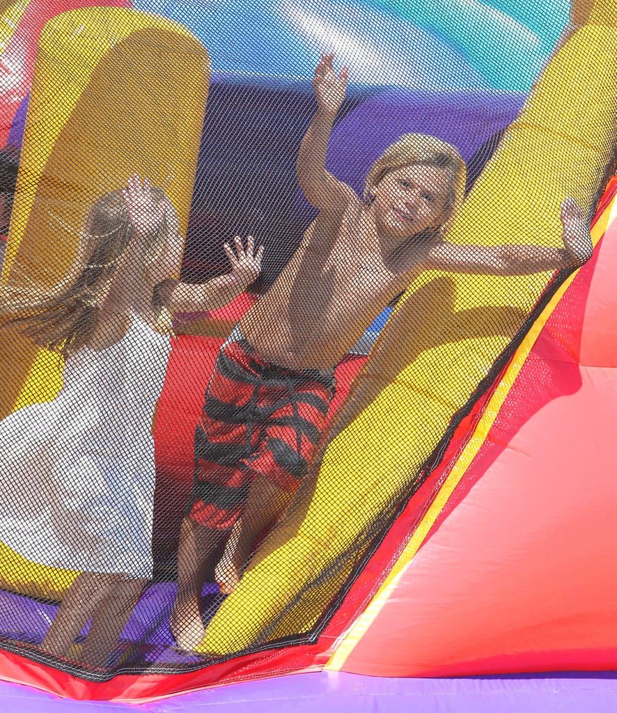 Kingston Rossdale enjoyed bouncing around with a little lady friend at Joel Silver's Memorial Day party in LA.