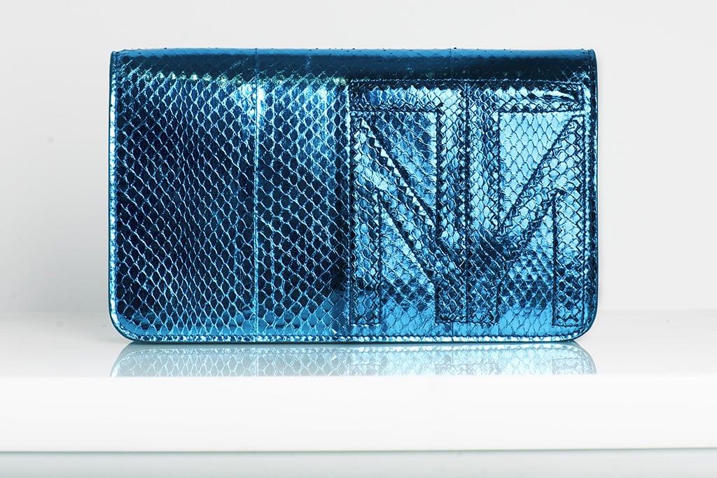 TM Enjoy Watersnake Clutch in Turquoise ($695) Photo courtesy of Tamara Mellon