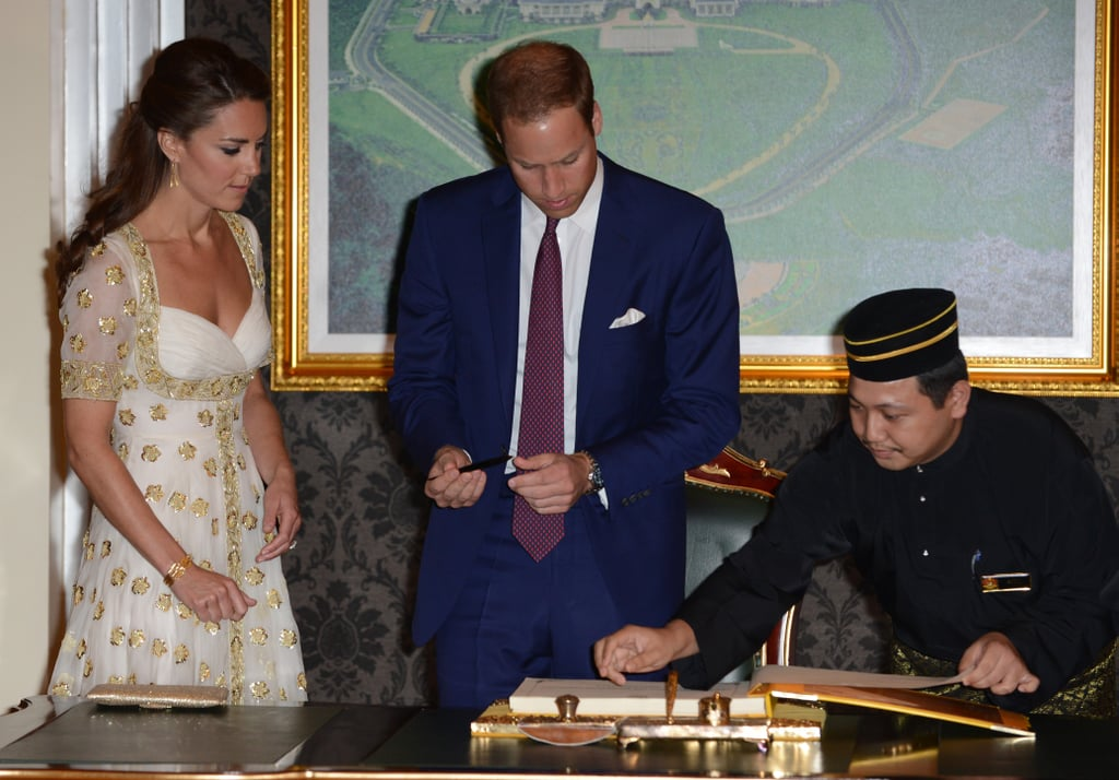 Prince William and Kate Middleton signed the guest book.