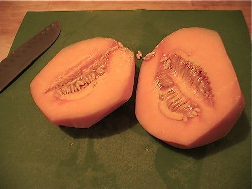 The cantaloupe's interior will be filled with messy seeds.