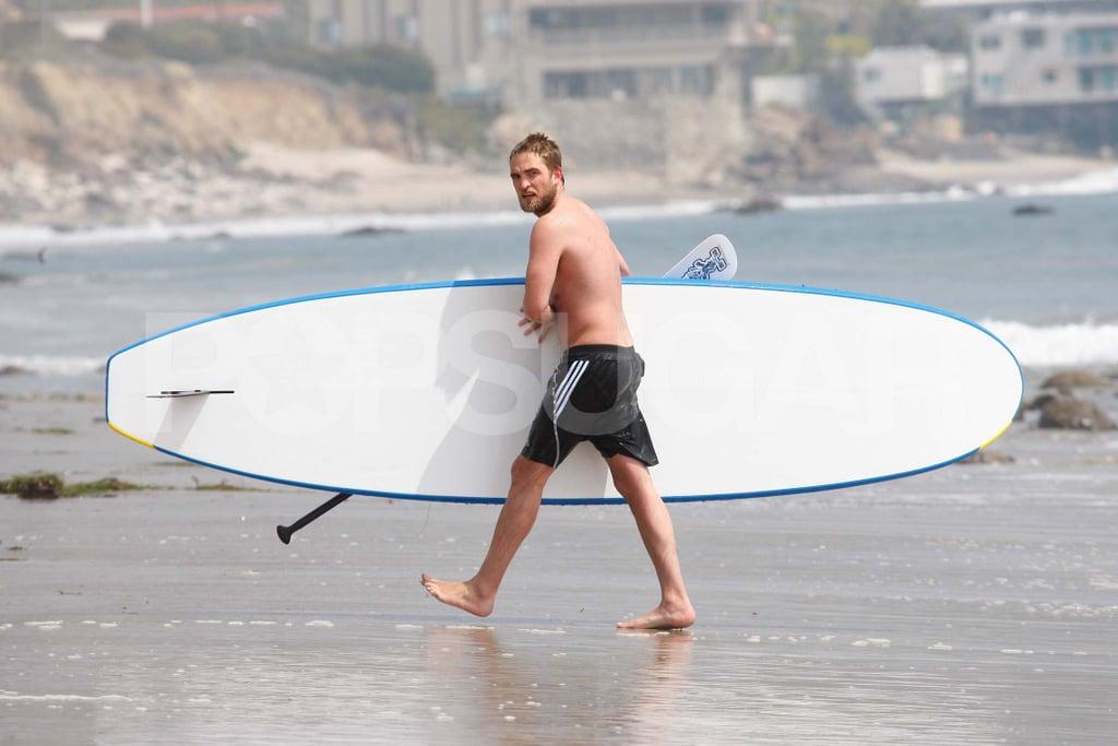 Robert Pattinson carried his paddleboard shirtless.