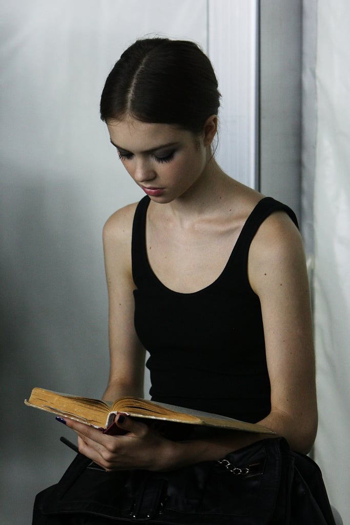 This Erdem model kept her eyes on her book backstage during Audi Fashion Festival in Singapore last year.
