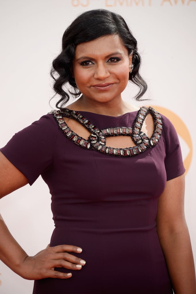 Mindy Kaling coupled her plum dress with an aubergine lip gloss, while her hair was styled in a softly curled updo.