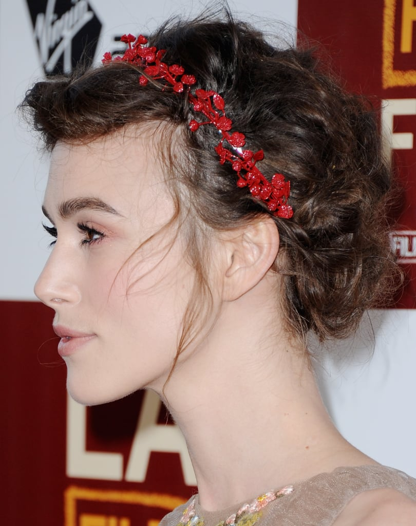 The gorgeous red headpiece picked up on the red floral embroidery on her gown.