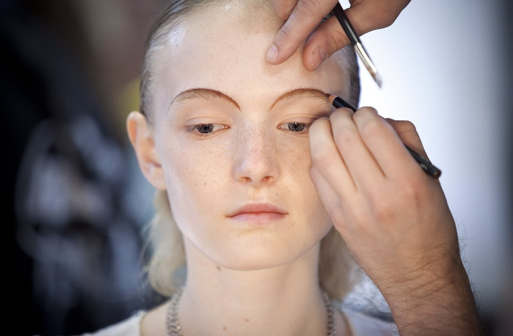"""Although bold brows have been a recent trend, key makeup artist Diane Kendal went for a thin and rounded brow look. She drew a guideline using NARS Mambo Eyeliner Pencil ($22). """"Even though we didn't conceal the eyebrow, the eye goes to the smudged line,"""" she explained."""