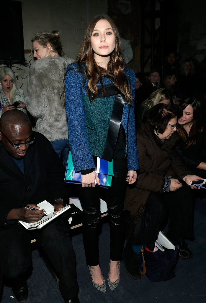 Elizabeth Olsen oozed effortless sophistication in an emerald-and-cobalt tweed jacket, slick leather pants, and dalmatian pumps at Proenza Schouler. Her matching colorblock clutch was the icing on her uptown-meets-downtown style.