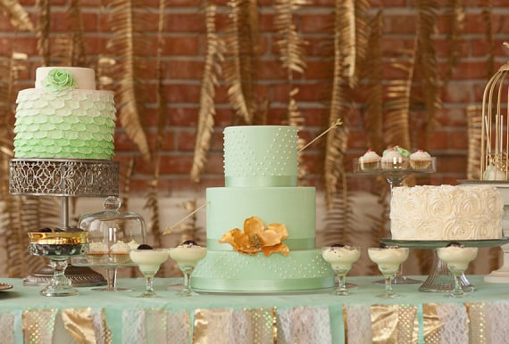 Although there's more than one cake on this dessert table, our eyes are on the mint-colored stunner in the middle. A delicate pearl pattern, large flower, and fun hue are all it takes to make this one swoon-worthy cake.  Photo by La Luz Photography via 100 Layer Cake