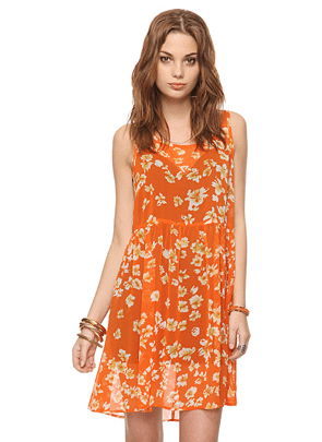 Add woven wedges to dress this look up for cocktails or an afternoon wedding.  Forever 21 Sheer Floral Dress ($18)