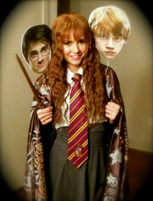 Nina Dobrev dressed as Hermione Granger in 2011, along with cutouts of her pals, Harry Potter and Ron Weasley.