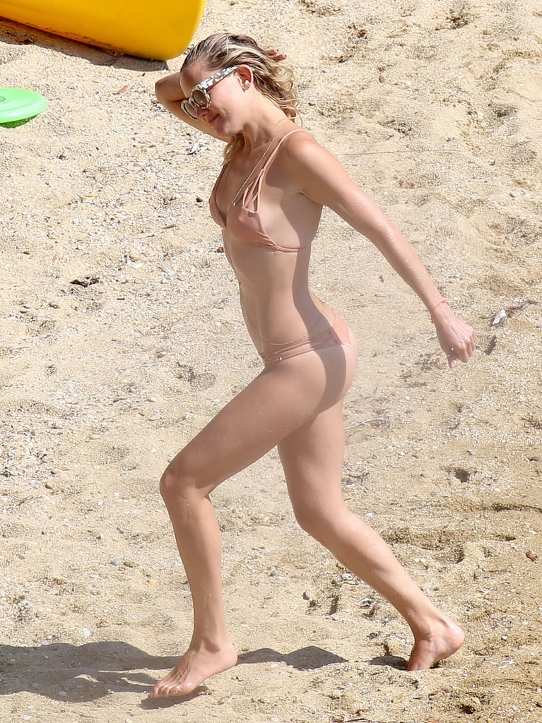 Kate showed off her toned body in a nude bikini on the beach with friends in Greece in June 2015.